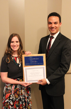 International Student Advisor Leah Buretta and International Club President Michael Brown accept the Service Project of the Year Award April 28 for the Cougarden.