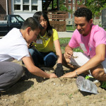 International Club President Michael Brown plants seeds with middle schoolers.