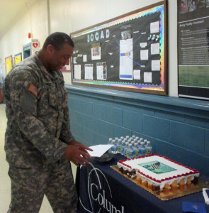 A servicemember enjoys cake at the Hunter Army Airfield campus's Military Recognition Day celebration.