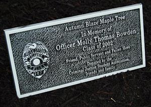 The plaque that sits below the Molly Thomas Bowden Memorial Tree on the Columbia College campus