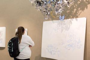 A student studies Alexis Callender's pieces.