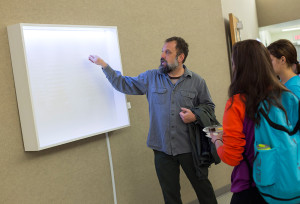 Eric Sweet discusses his art with students.