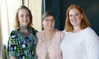 Three Wishes for Her Founder Sylvia McKelvey, center, with daughters Anna Tetreault, left, and Shonda Jones.