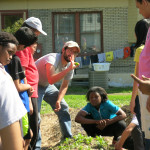 Columbia Center for Urban Agriculture, teaches middle school students how to harvest spinach.