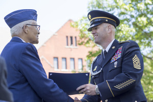 Col. Charles McGee, left, presents his scholarship to Mike Lederle, director of Veterans Services, who accepted the award on behalf of Orlando campus student and U.S. Army veteran Aron Gonzalez at Military Recognition Day May 21 on main campus.
