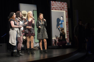 Members of a Capella group Perfect Octave, directed by Laura Rowe, cemter.