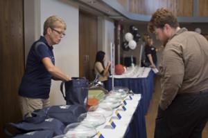 Ann Merrifield, director of Business Development, mans the swag bag raffle table.