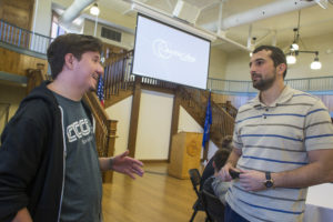 From left, senior Ryan Frappier and alumnus Miroslav Lukic '10 talk at the Computer and Mathematical Sciences department networking lunch in Dorsey Gym. (Photo by Kaci Smart)