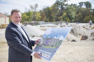 Tim Rich, a 1989 alumnus and executive director of Welcome Home, stands at the future site of the organization's new shelter for homeless veterans. (Photo by Kaci Smart)