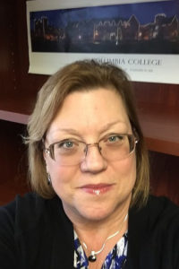 Dr. Lois Marie Adrian-Hollier, director