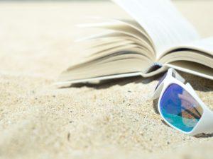 sand, book, glasses