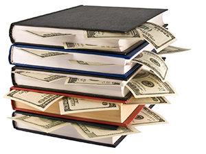 Dollars stuffed inside books
