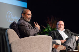 Ron Stallworth speaking with Dr. Scott Dalrymple in the background
