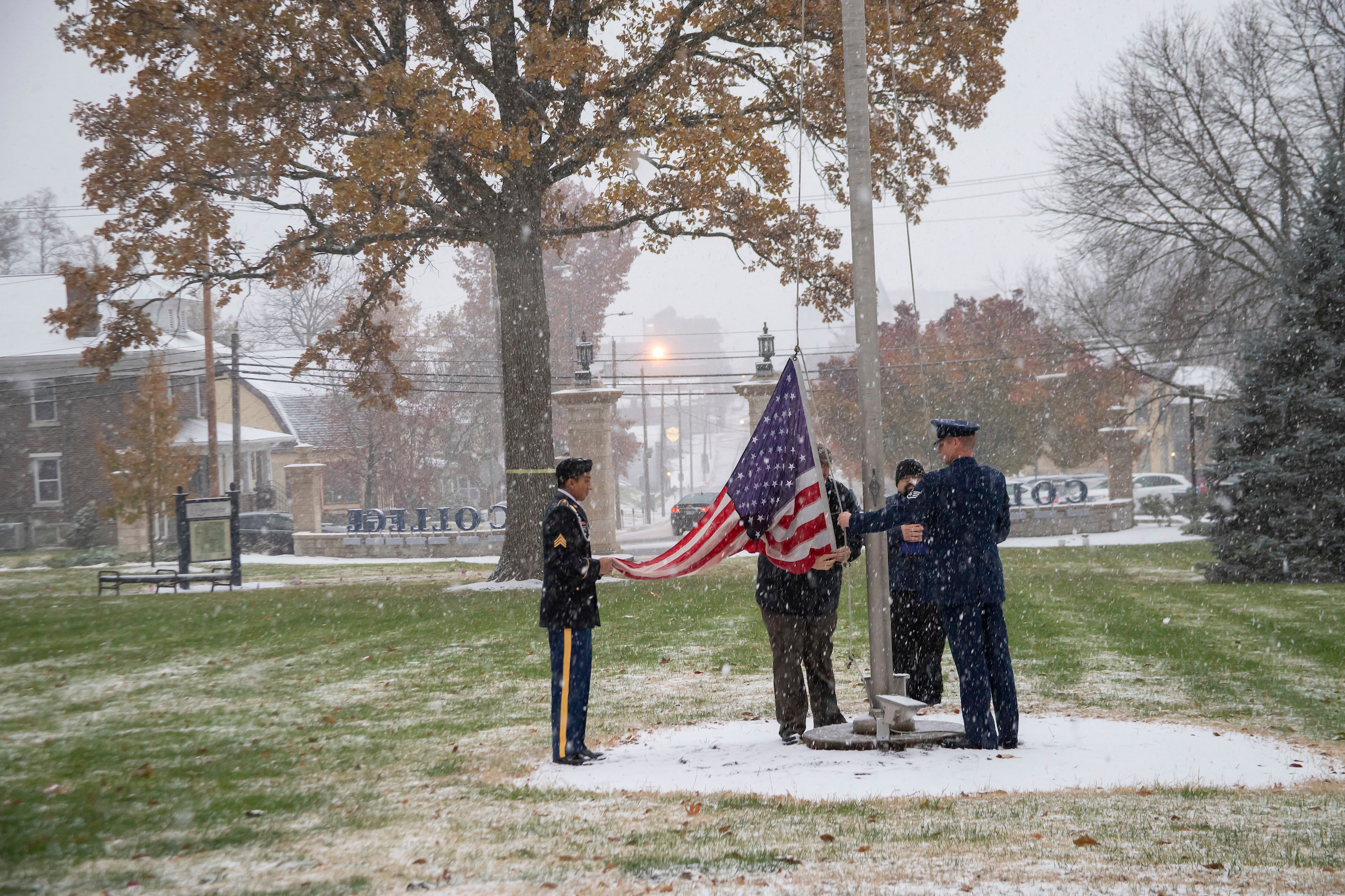 Honor Guard raising the American flag on Bass Commons