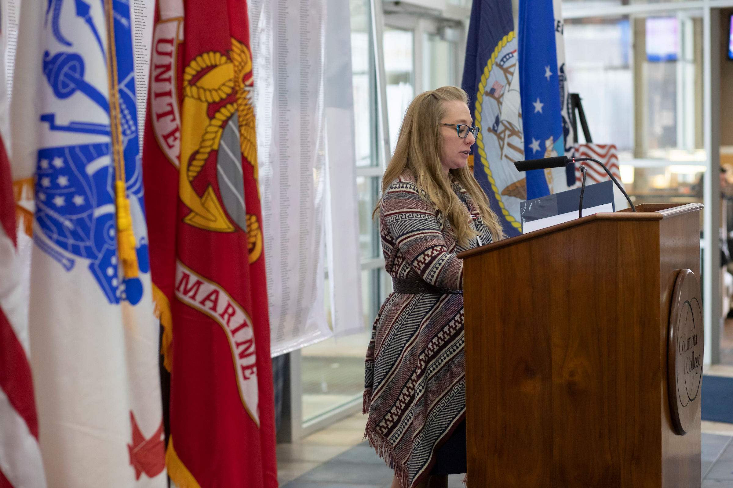 Columbia College Systems Analyst Jen Boyt, an Iraq veteran of the Army National Guard, reads names during the National Roll Call.