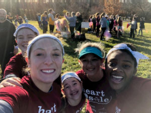 Libby Marko with girls at a Girls on the Run event