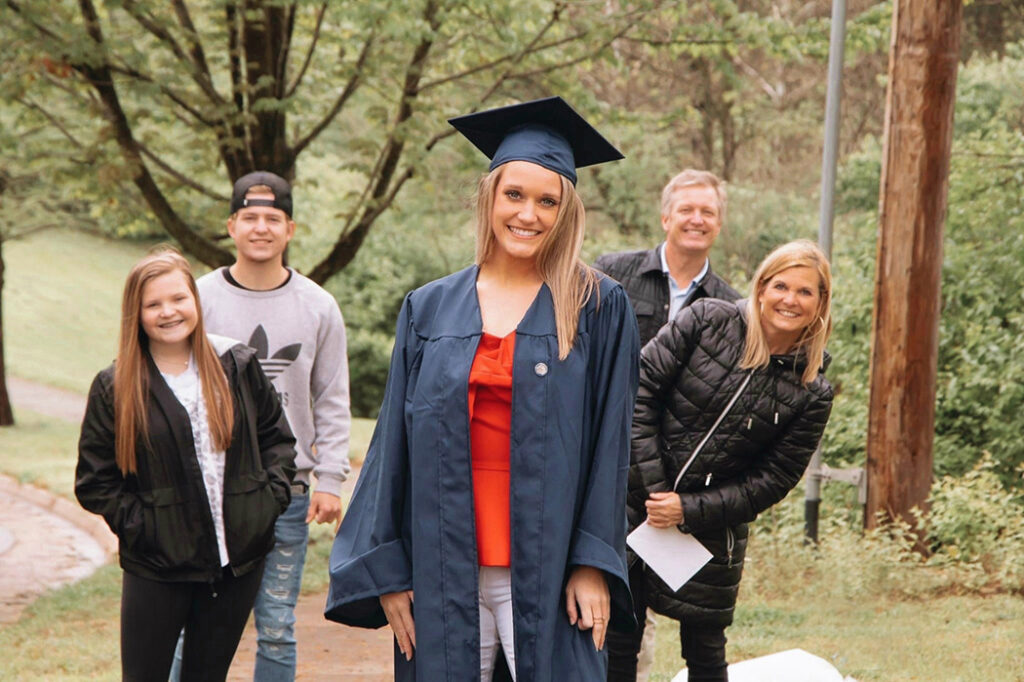 Klein family with Molly in front in her cap and gown