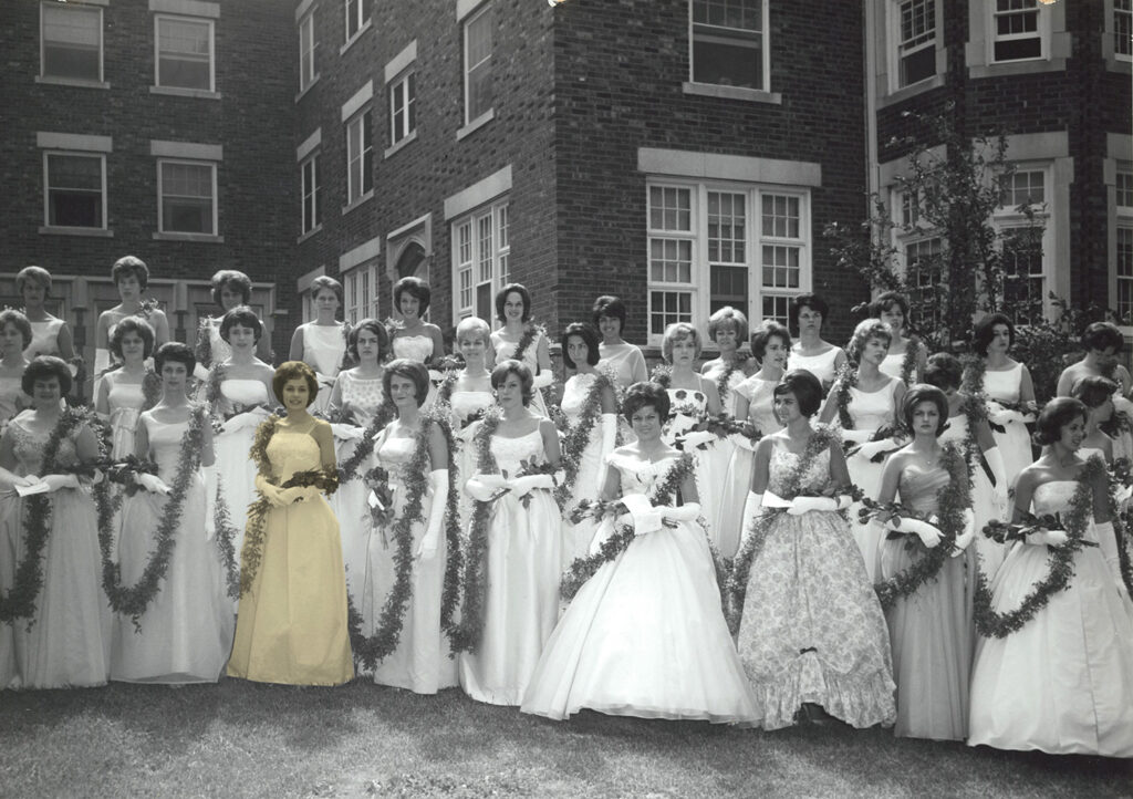 Women in formal gowns in front of Missouri Hall