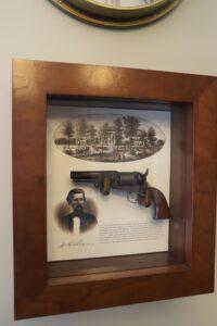 Shadow box containing JK Rogers' gun